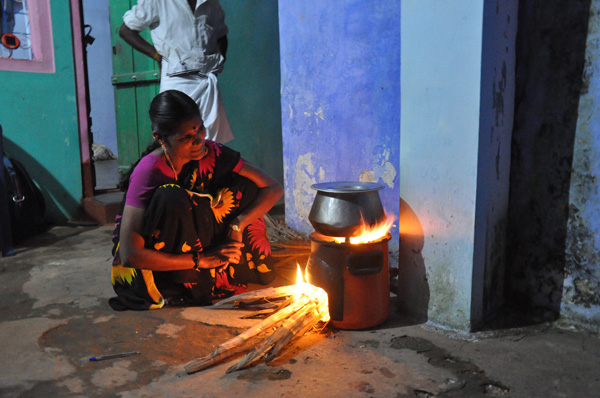 Cooking on an Envirofit improved cookstove. Photo by Meera Subramanian